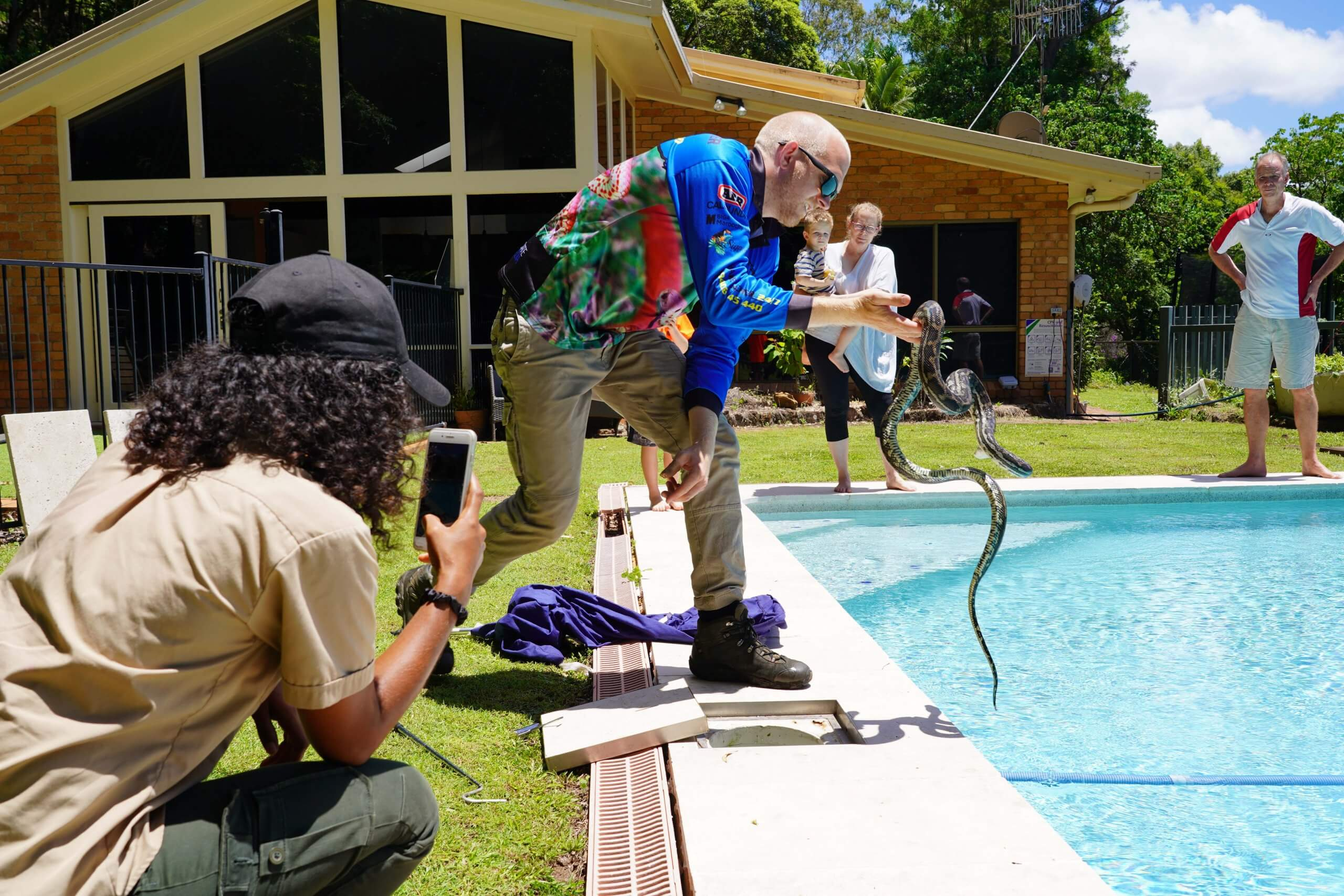 Watching on a python is pulled out of pool