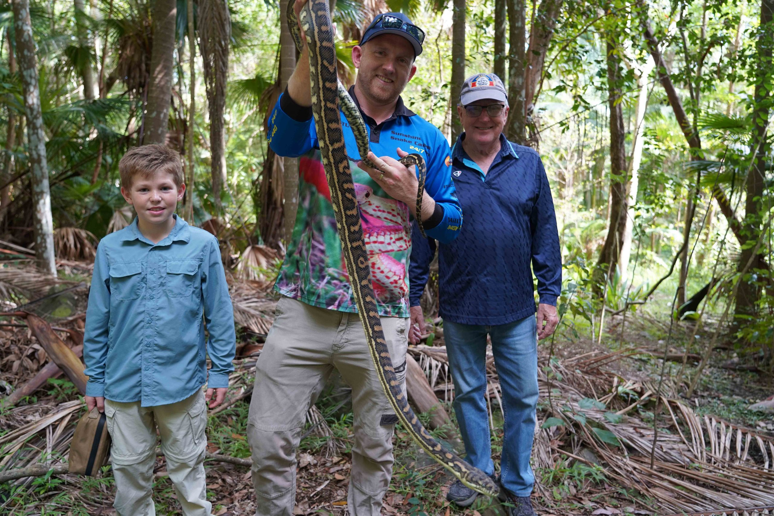 On a snake catching tour with Stu and the team holding carpet python