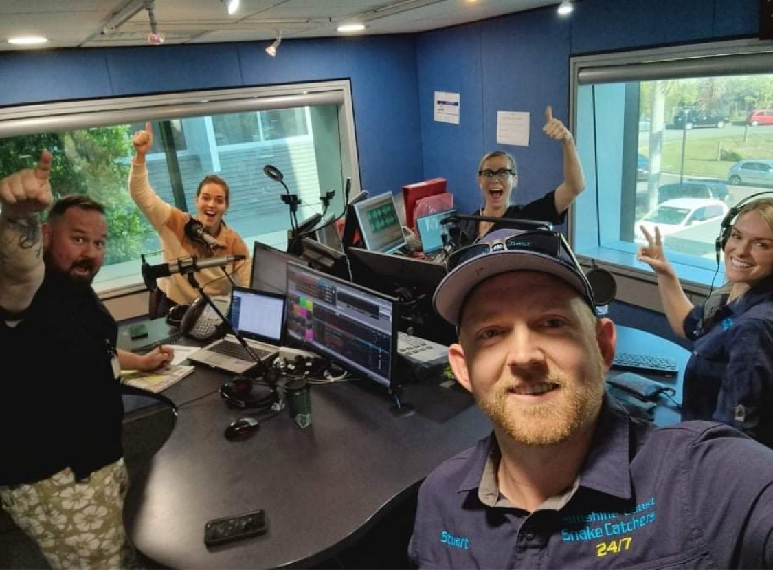 Snake catching team on air with Hot 91 radio